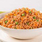 Cómo preparar un delicioso arroz rojo para acompañar tus platillos
