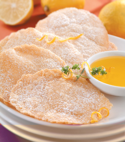 Buñuelos con salsa de naranja