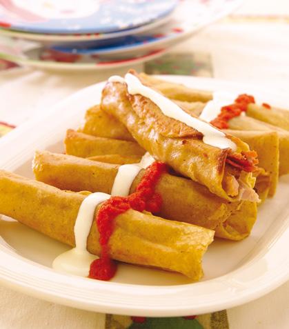 Tacos dorados de pierna envinada