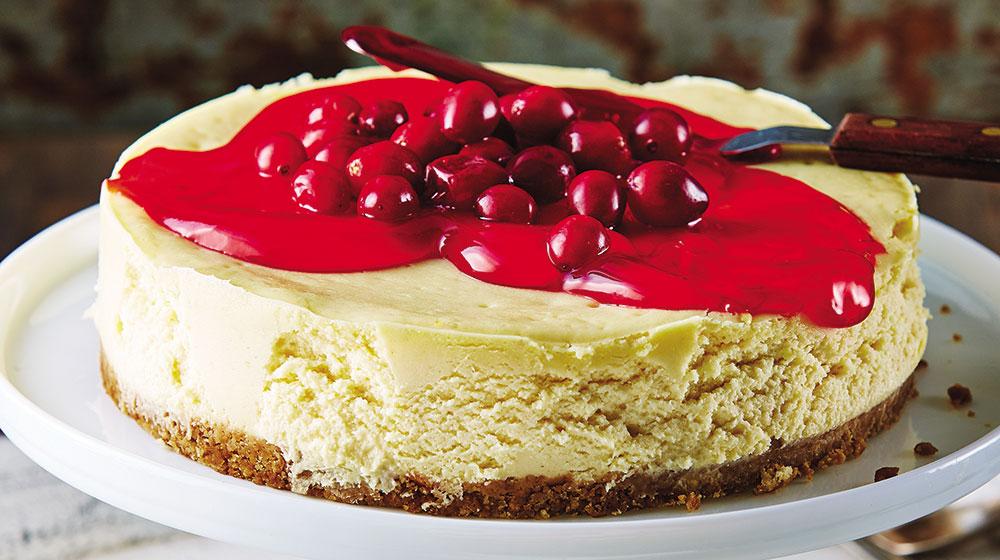 Cheesecake con mermelada de arándano fresco