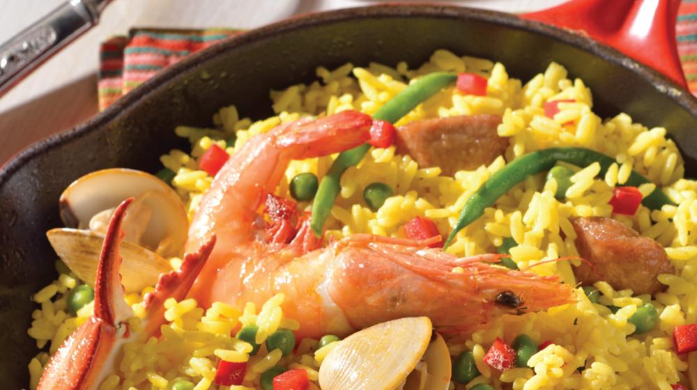 Prepara una paella valenciana tradicional